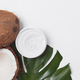 Natural coco cosmetic moisturizer cream on monstera palm leaf - PhotoDune Item for Sale