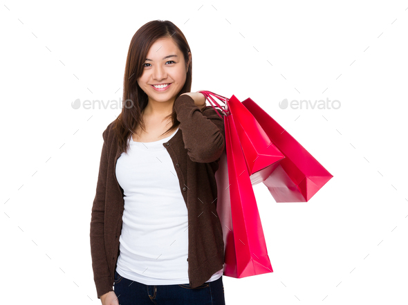 Asian Woman hold with shopping bag - Stock Photo - Images