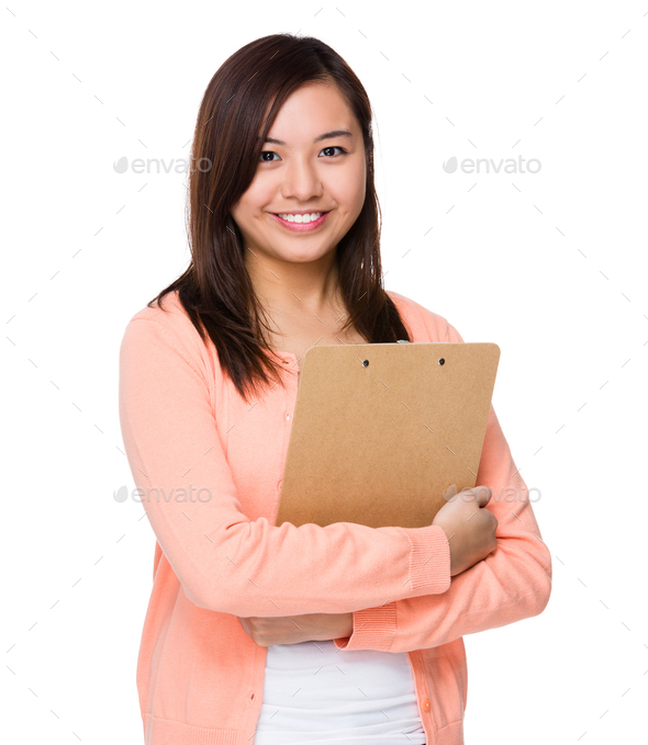 Asian Woman hold with clipboard - Stock Photo - Images