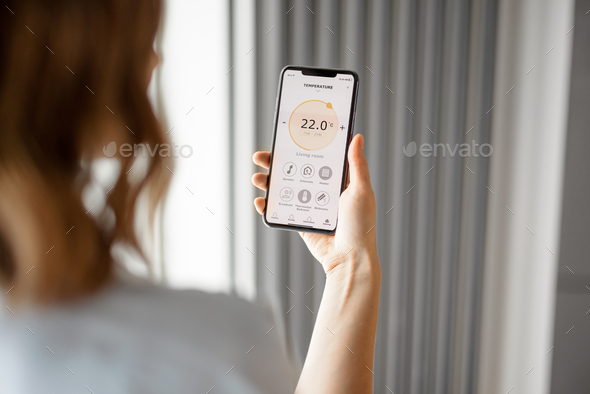Smartphone with launched application for temperature adjustment - Stock Photo - Images