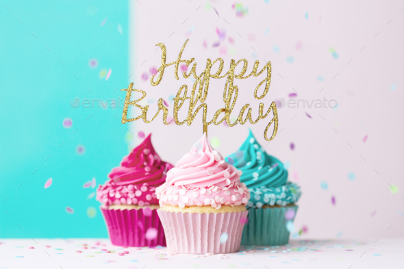 Happy birthday cupcakes in pink and blue - Stock Photo - Images