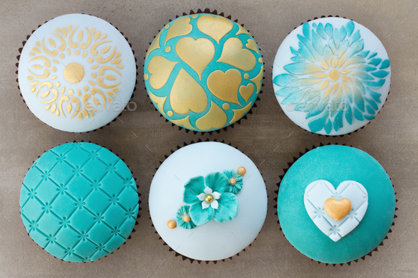 Teal and gold wedding cupcakes - Stock Photo - Images