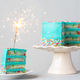 Birthday cake with colorful frosting and sparkler - PhotoDune Item for Sale