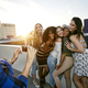 A group of young women partying on a city rooftop at dusk - PhotoDune Item for Sale