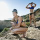 Two sisters, triathletes in training in swimwear, swimhats and goggles. - PhotoDune Item for Sale