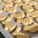 Ready for baking cookies cut in shape of rabbit, egg and chicken on parchment paper - PhotoDune Item for Sale