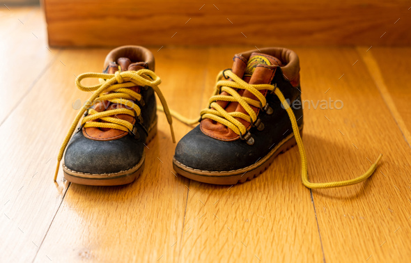 Baby Shoes On Wood Closeup View Child Booties Blue And Yellow Color Stock Images Page Everypixel