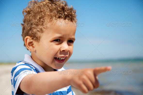 Little Kid Pointing at Something Interesting - Stock Photo - Images