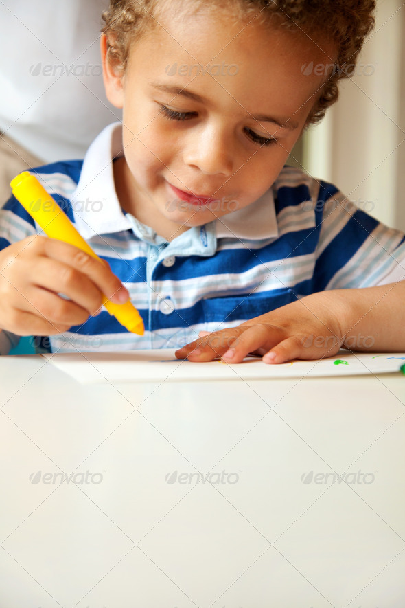 Young Boy Busy Doing His Art Activity - Stock Photo - Images