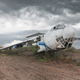 Abandoned old Soviet cargo plane on the ground in cloudy weather - PhotoDune Item for Sale