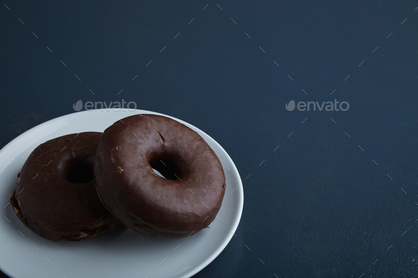 Two donuts isolated on corner table - Stock Photo - Images