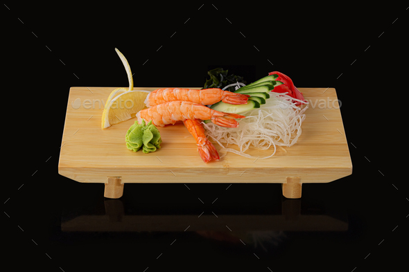 japanese foods sashimi raw sliced fish, shellfish or crustaceans on wooden board - Stock Photo - Images