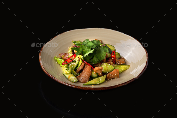 Chinese beaten cucumbers salad with pork, dark background, place for text - Stock Photo - Images