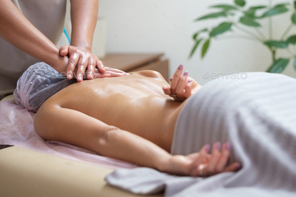 Caucasian woman getting a spine massage in the spa salon - Stock Photo - Images