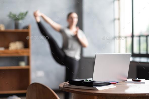 Blurred photo caucasian woman working yoga exercise doing balance exercise. - Stock Photo - Images