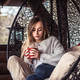 girl with a Cup of tea in a comfortable chair - PhotoDune Item for Sale