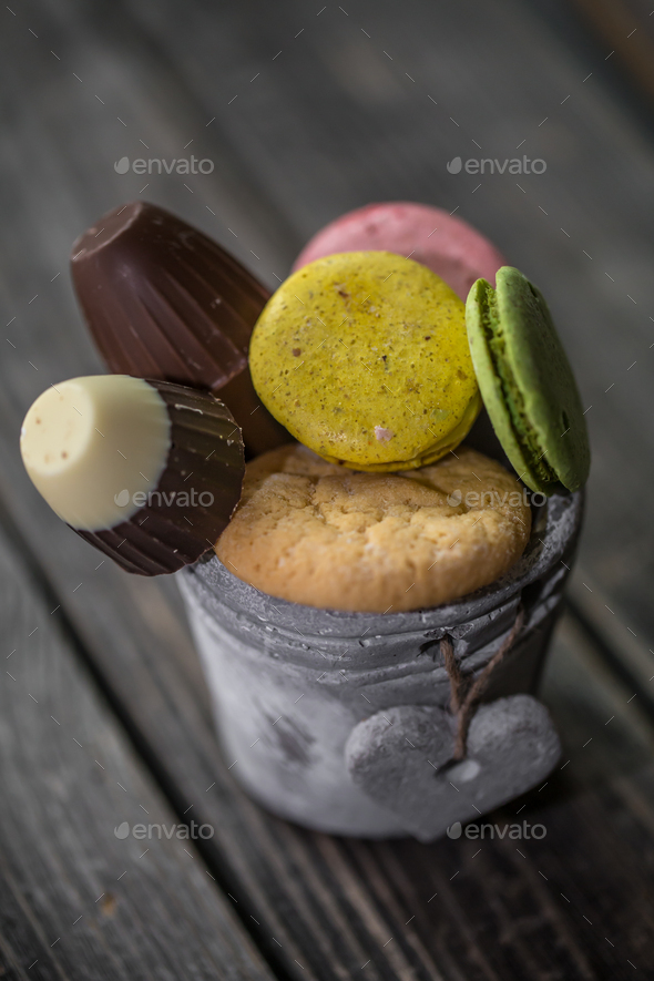 chocolates on a stick in  bucket - Stock Photo - Images