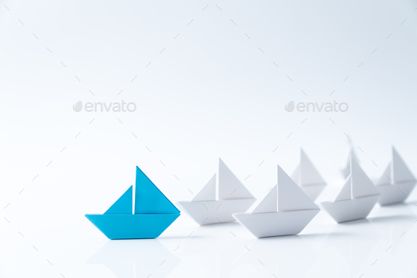 Leadership conceptual using blue paper ship - Stock Photo - Images
