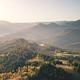 Fog sunrise at mountain village aerial. Autumn nobody nature landscape. Green spruce, leaf forest - PhotoDune Item for Sale