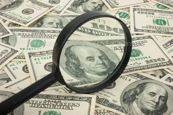 Hundred dollar banknotes under magnifying glass - Stock Photo - Images