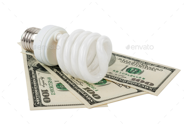 Energy saving lamp and money - Stock Photo - Images