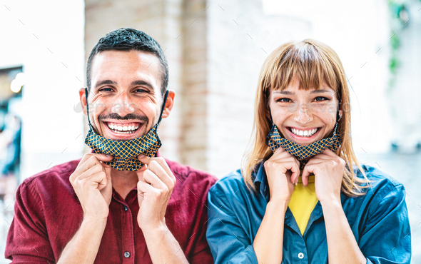 Happy couple in love smiling with open face mask - Stock Photo - Images