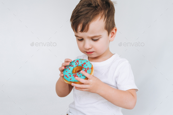 Placeit - Funny cute toddler boy with donut - Stock Photo - Images