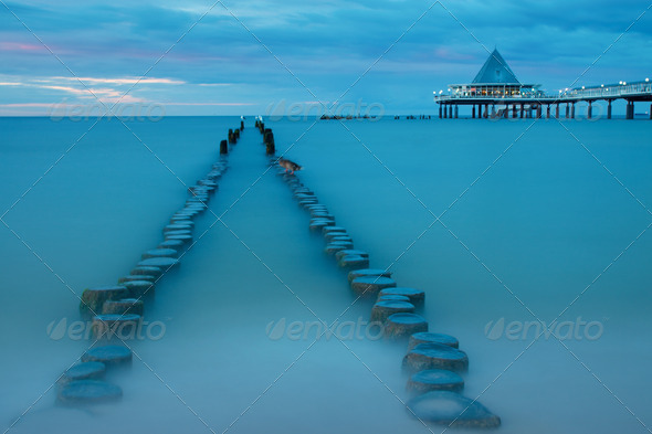 Old and new pier at dusk - Stock Photo - Images