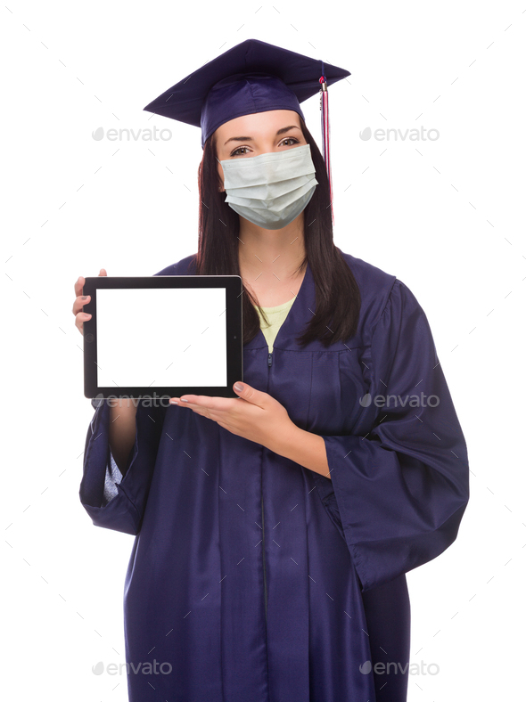 Graduating Female Wearing Medical Face Mask and Cap and Gown  Holding Blank Computer Tablet Isolated - Stock Photo - Images