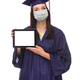 Graduating Female Wearing Medical Face Mask and Cap and Gown  Holding Blank Computer Tablet Isolated - PhotoDune Item for Sale