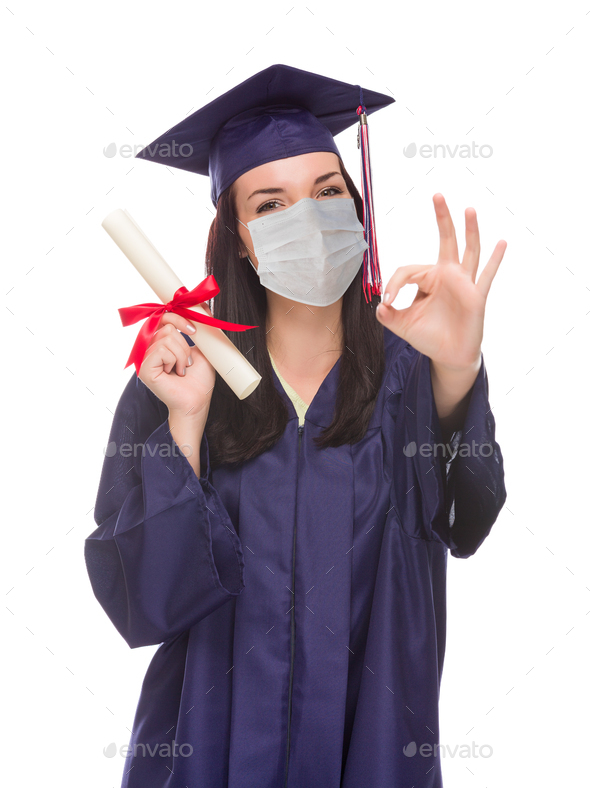 Graduating Female Wearing Medical Face Mask and Cap and Gown  Isolated on a White Background - Stock Photo - Images