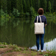 Placeit - Woman carrying tote bag on the lake shore, mockup - PhotoDune Item for Sale