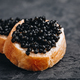 Black caviar sandwiches with butter on dark background - PhotoDune Item for Sale