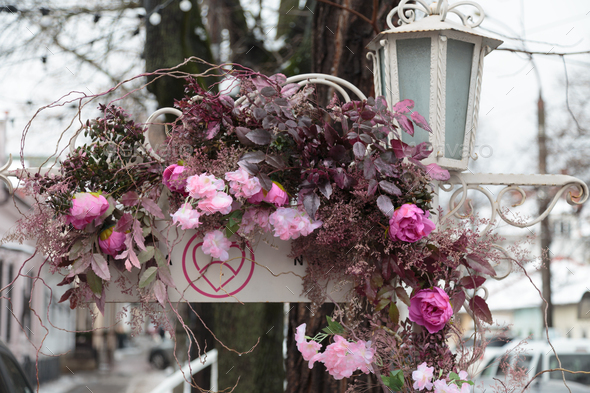 City street is decorated with artificial flowers. - Stock Photo - Images