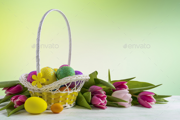 Happy Easter elegant background with painted eggs in yellow basket - Stock Photo - Images
