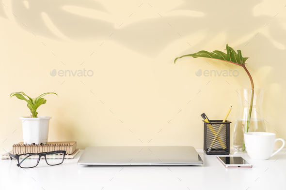 Modern and stylish workspace mock up with laptop and desk office supplies