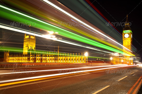 Big Ben London with lights from incoming bus - Stock Photo - Images