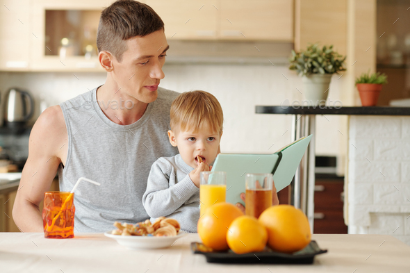 Family having breakfast at home - Stock Photo - Images