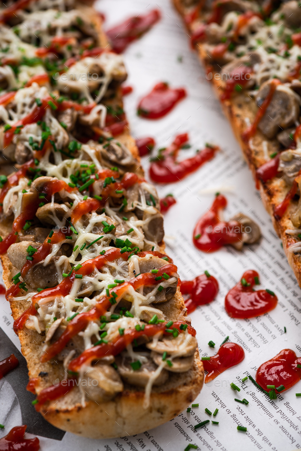 Polish Street Food Zapiekanka Baguette with Mushrooms, Onion, Cheese and Ketchup - Stock Photo - Images