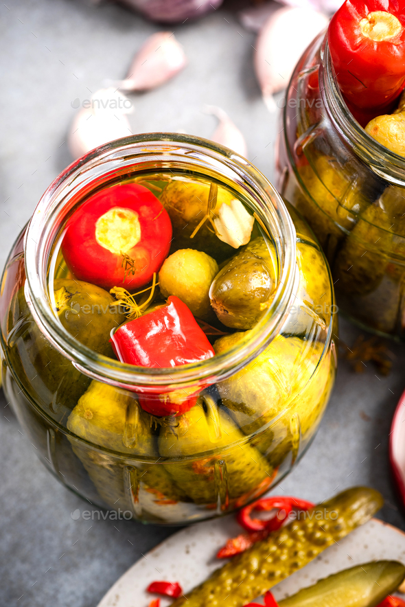 Pickled Gherkin Cucumber with Red Pepper. Homemade Preserves Marinated Food in Jar - Stock Photo - Images