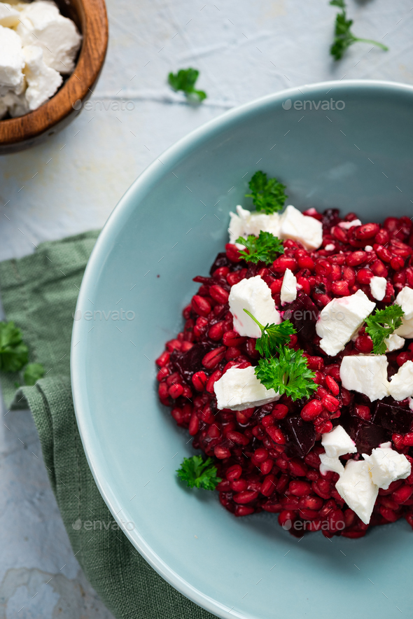 Risotto Made with Groats and Beetroot Served with Feta Cheese - Stock Photo - Images