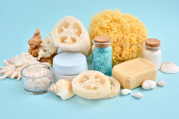 Spa accessories - sea salt, cream, sea sponge, soap and shells in cosmetics set for spa - Stock Photo - Images