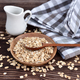 Oat flakes uncooked in wooden bowl with spoon on a dark wooden table. Concept of healthy eating - PhotoDune Item for Sale
