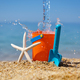 Bright plastic сhildren's beach toys and a starfish on sand near sea. Summer vacation concept - PhotoDune Item for Sale