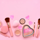 Makeup brushes and decorative cosmetics, hearts on a pink background. Top view - PhotoDune Item for Sale