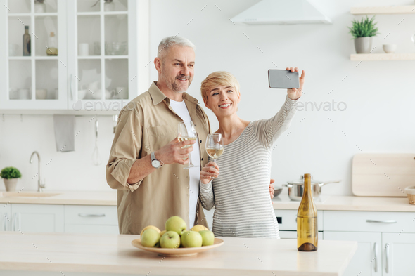 Family dinner at home, traditional lunch at holiday and toast during video call - Stock Photo - Images