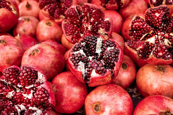 Cracked pomegranate. Ripe Pomegranates Background - Stock Photo - Images