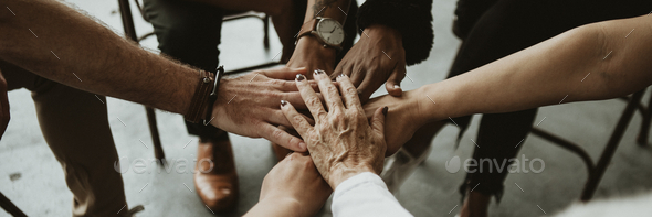 Group of diverse team joining hand in the middle - Stock Photo - Images