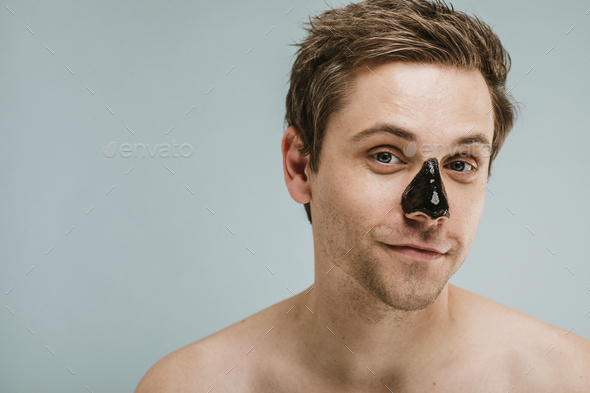Portrait of a man wearing black pore mask - Stock Photo - Images