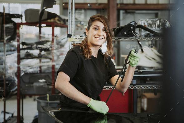 Happy female car mechanic - Stock Photo - Images